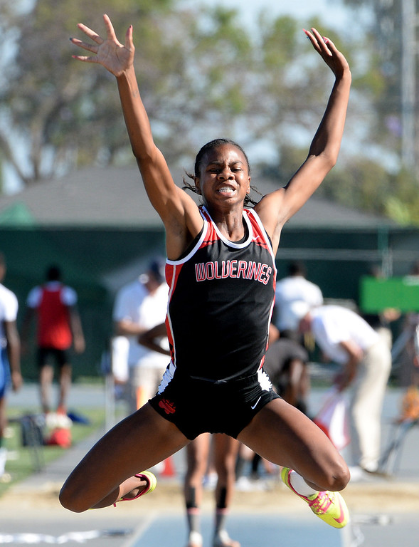 Description of . Harvard Westlake's Courtney Corrin competes in the long jump during the CIF-SS Masters Track and Field meet at Falcon Field on the campus of Cerritos College in Norwalk, Calif., on Friday, May 30, 2014.   (Keith Birmingham/Pasadena Star-News)