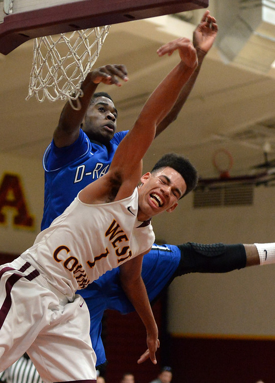 Description of . Diamond Ranch's Ernest Ugoagu blocks the shot of West Covina's Michael Fallon (1) in the first half of a prep basketball game at West Covina High School in West Covina, Calif., on Wednesday, Jan. 8, 2014. (Keith Birmingham Pasadena Star-News)