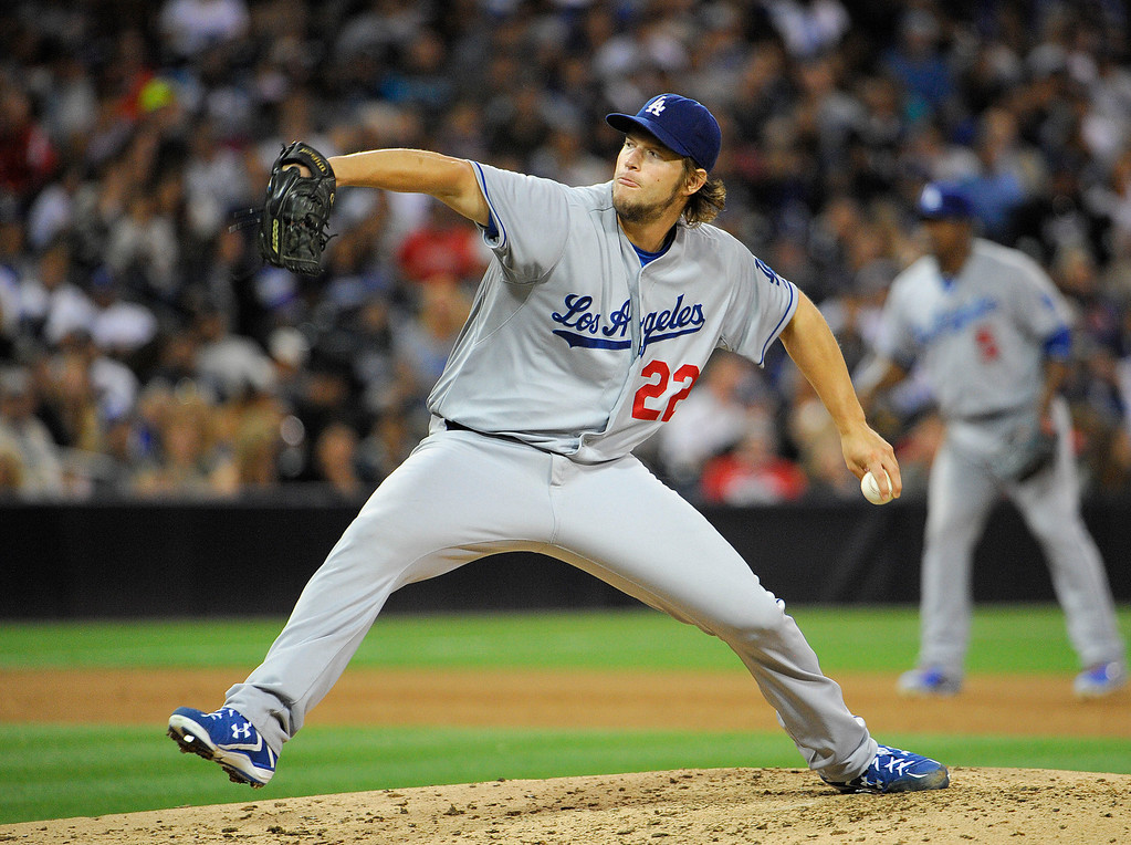 Description of . Clayton Kershaw #22 of the Los Angeles Dodgers pitches during the fifth inning of a baseball game against the San Diego Padres at Petco Park on September 21, 2013 in San Diego, California.   Dodgers won 4-0.   (Photo by Denis Poroy/Getty Images)