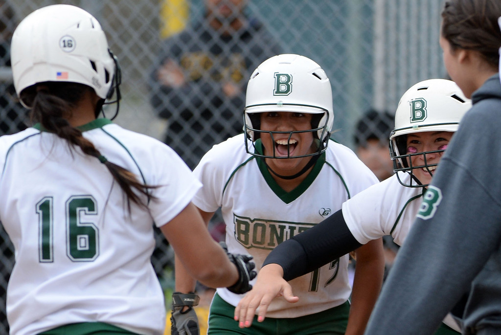 Description of . Bonita teammates wait for Chloe Melanson (16) at home plate after she hit a two run home run in the sixth inning of a prep softball game against West Covina at Los Flores Park in La Verne, Calif., on Thursday, March 27, 2014. Bonita won 6-3. (Keith Birmingham Pasadena Star-News)