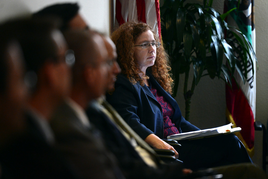 Description of . Sitting next to Arcadia officials, Holly Whatley, asst. city attorney for Sierra Madre, waits to present her case as the two cities go before the Raymond Basin Management Board Thursday, March 13, 2014 in a water dispute. Sierra Madre accuses Arcadia of stealing water out of their aquifer in the eastern unit of the Raymond Basin. The well in dispute is Arcadia's Anoakia Well.  (Photo by Sarah Reingewirtz/Pasadena Star-News)