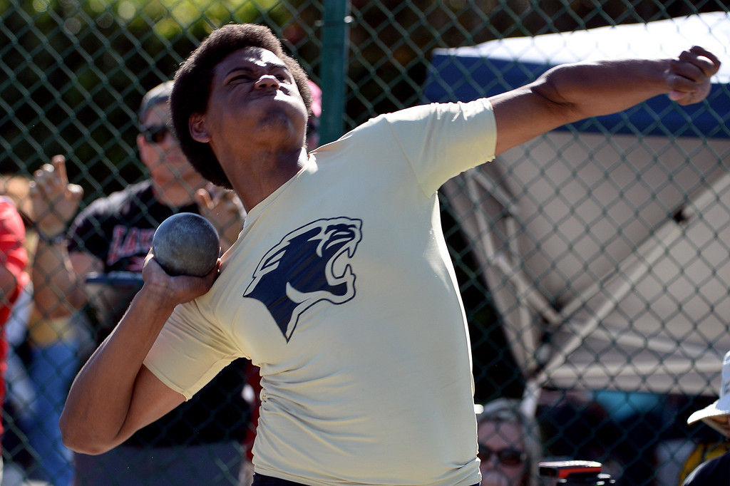 Description of . Peninsula's Mitchel Charles competes in the shot put during the CIF-SS Masters Track and Field meet at Falcon Field on the campus of Cerritos College in Norwalk, Calif., on Friday, May 30, 2014.   (Keith Birmingham/Pasadena Star-News)