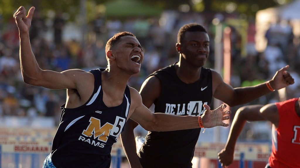 Description of . Millikan's Misana Viltz wins the 110 meter hurdles during the CIF California State Track & Field Championships at Veteran's Memorial Stadium on the campus of Buchanan High School in Clovis, Calif., on Saturday, June 7, 2014. 