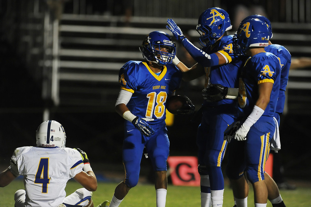 Description of . Bishop Amat's Trevon Sidney (18) reacts with teammates after knocking away a pass intended for Charter Oak's Donavin Washington (4) in the first half of a prep football game at Bishop Amat High School in La Puente, Calif. on Friday, Sept. 20, 2013.    (Photo by Keith Birmingham/Pasadena Star-News)