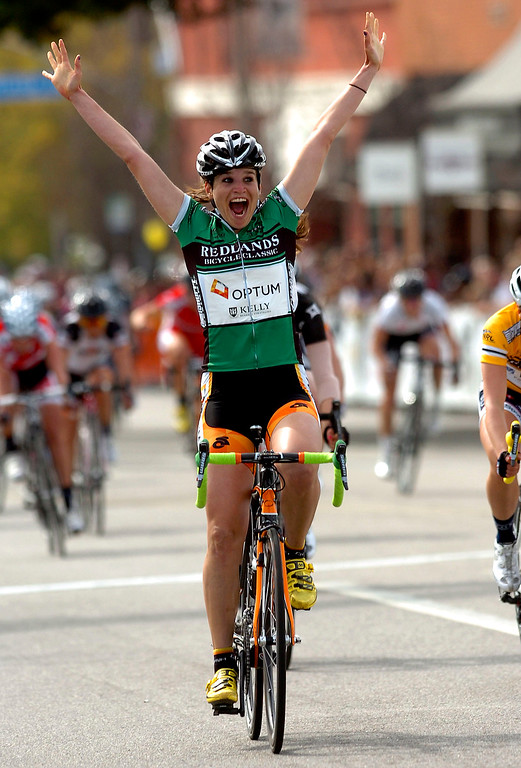 Description of . Joelie Numainville of Optum Pro Cycling reacts as she finishes first in the City of Redlands Criterium for Women during the 28th Annual Redlands Bicycle Classic March 24, 2012.  (Photo by Gabriel Luis Acosta/The Sun)
