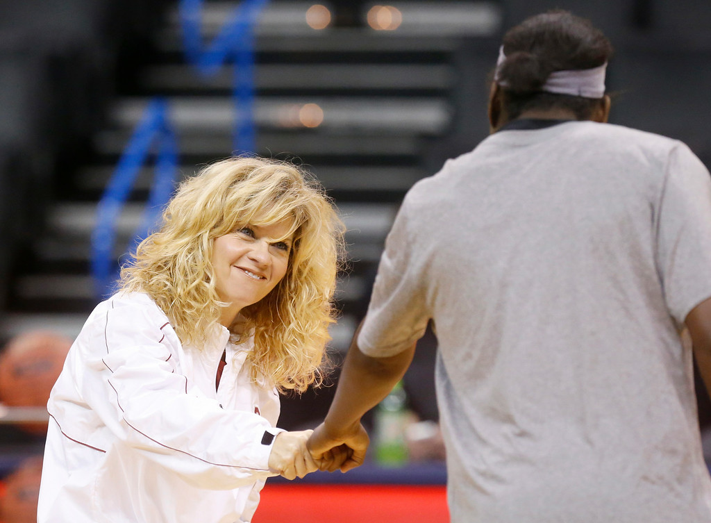 Description of . Oklahoma head coach Sherri Coale fist bumps with forward Felisha Gibbs, right, during a team practice for the Big 12 women\'s NCAA college basketball tournament in Oklahoma City, Friday, March 7, 2014. Oklahoma faces Texas on Saturday. (AP Photo/Sue Ogrocki)