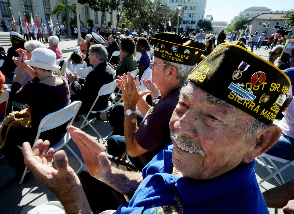 Description of . Members of Sierra Madre Post, Stan Pinta of Arcadia, and Art Contreras, right, enjoying the speakers at Pasadena's annual Veterans Day Ceremony in front of Pasadena City Hall at Centennial Square. Monday, November 11, 2013. The public, veterans, their families, friends and all uniformed military and first-responders, joined together to help honor the men and women of the U.S. Armed Forces. This year's event, while recognizing the important contributions made by all veterans, will have a special emphasis on honoring the nation's youngest and newest veterans. The Veterans Day celebration is co-sponsored by the Pasadena Veterans Day Committee and the City of Pasadena.(Photo by Walt Mancini/Pasadena Star-News)