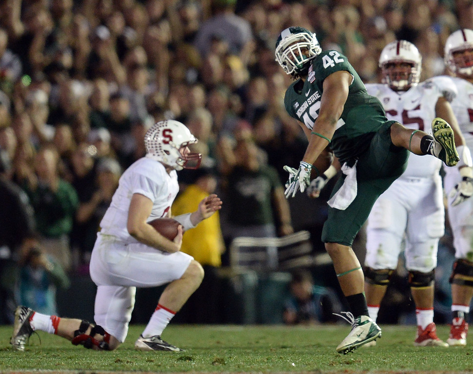 Description of . Michigan State's Denzel Drone #42 reacts after dropping Stanford quarterback Kevin Hogan #8 during the 100th Rose Bowl game in Pasadena Wednesday, January 1, 2014. Michigan State defeated Stanford 24-20. (Photo by Hans Gutknecht/Los Angeles Daily News)