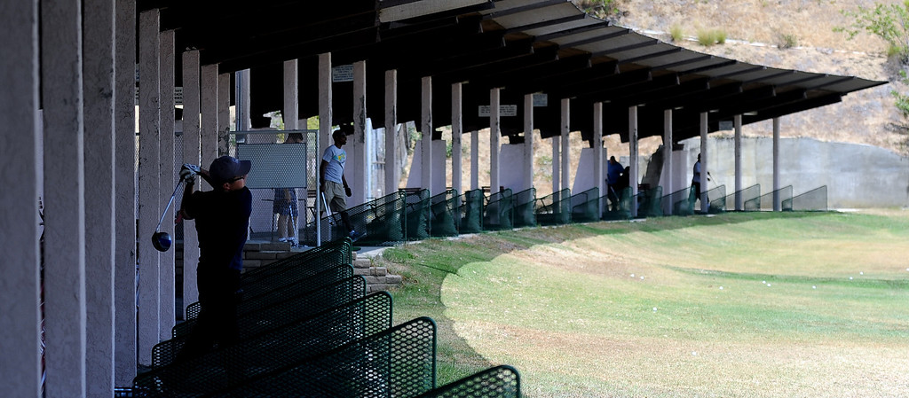 Description of . Golfer practice on the driving range as the Monterey Park Golf course may soon be under new ownership, and that means patrons can expect $900,000 in upgrades within the first 12 months. that the
