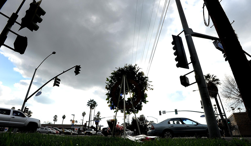 Description of . A wreath remains at the site of a police ambush on the corner of Arlington and Magnolia Avenues in Riverside as seen February 9, 2013.  Riverside Police Officer Michael Crain was shot and killed here. (Staff photo by Gabriel Luis Acosta/The Sun)