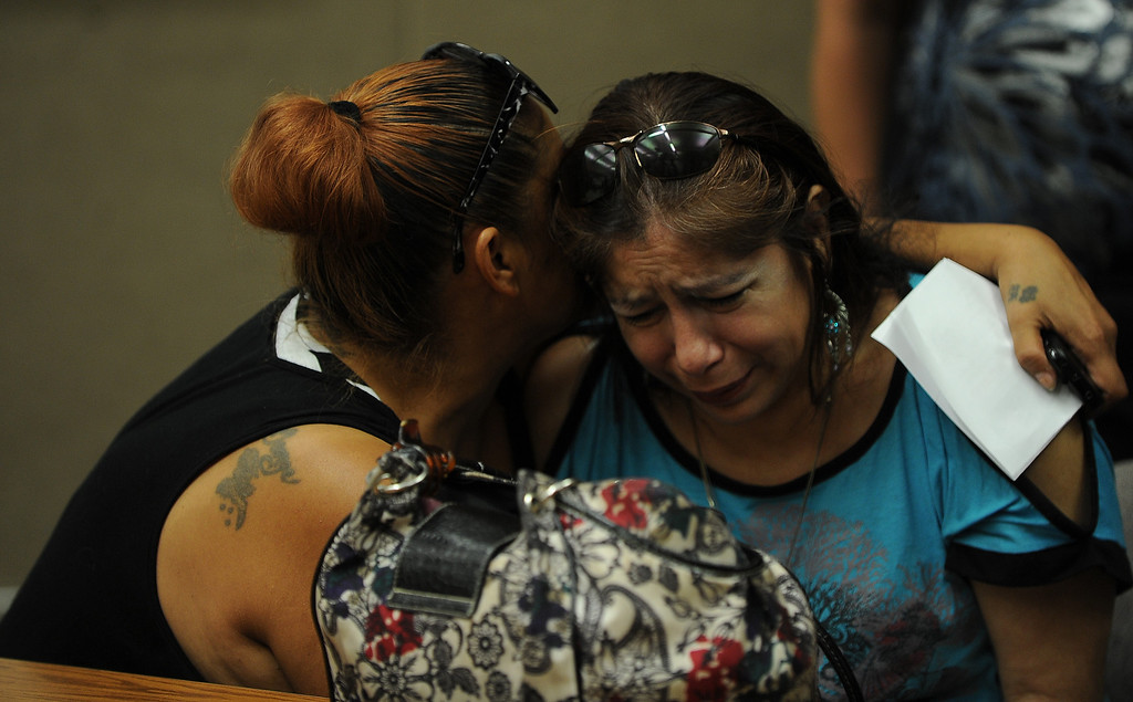 Description of . Rosie Curonilla, right, mother of Daniel Olivera is comfort by a family member during a press conference at the San Bernardino County Sheriff's Head quarters Thursday August 22, 2013 in San Bernardino. Daniel Olivera 26, of Hesperia was shot and killed at the AM/PM Arco convenience store on August 11, 2013 in Victorville.LaFonzo Carter/Staff Photographer