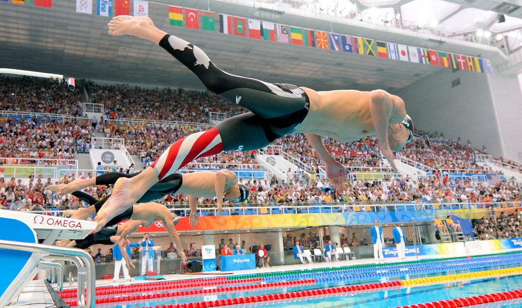 Description of . United States' Michael Phelps starts to the men's 200-meter butterfly final  during the swimming competitions in the National Aquatics Center at the Beijing 2008 Olympics in Beijing, Wednesday, Aug. 13, 2008. Phelps won gold and set a new world record. (AP Photo/Mark J. Terrill)