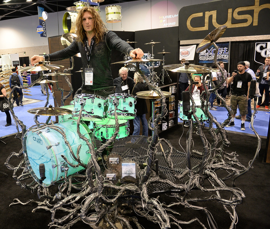 Description of . Artist and drummer Shawn Lowery shows his Life Tree drum sculpture in the Crush drums booth during NAMM (National Association of Music Merchants), the world wide music trade show at the Anaheim Convention Center in Anaheim on Sunday January 26, 2014. NAMM is a music trade show drawing retailers and other industry people to Anaheim for four days of everything music. (Staff Photo by Keith Durflinger/San Gabriel Valley Tribune)