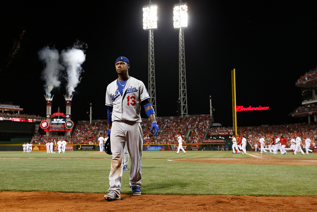 Description of . Hanley Ramirez #13 of the Los Angeles Dodgers walks off the field after striking out to end the game against the Cincinnati Reds at Great American Ball Park on September 6, 2013 in Cincinnati, Ohio. The Reds won 3-2. (Photo by Joe Robbins/Getty Images)