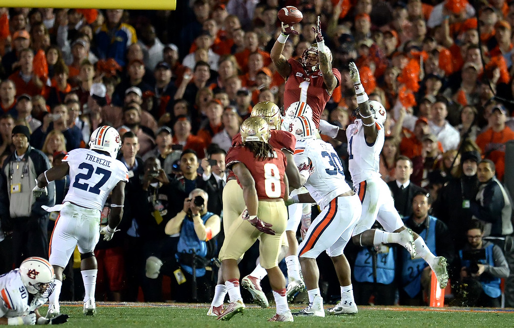 Description of . Florida State wide receiver Kelvin Benjamin (1) catches the winning touchdown pass with 13 seconds left in the fourth quarter of the BCS National Championship game at the Rose Bowl in Pasadena, Calif., on Monday, Jan. 6, 2014. Florida State won 34-31.(Keith Birmingham Pasadena Star-News)