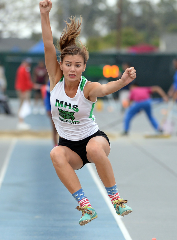 Description of . Monrovia's Madison Herrera competes in the Division 3 long jump during the CIF Southern Section track and final Championships at Cerritos College in Norwalk, Calif., on Saturday, May 24, 2014. 