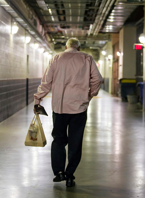 Description of . Charlie Manuel walks out of the stadium after being fired as manager of the Philadelphia Phillies before a baseball game against the Los Angeles Dodgers, Friday, Aug. 16, 2013, in Philadelphia. Manuel, the winningest manager in franchise history, was replaced by Hall-of-Famer and former Chicago Cubs second baseman Ryne Sandberg, the Phillies' third-base coach. Sandberg takes over beginning with Friday night's game against the NL West-leading Dodgers. (AP Photo/Chris Szagola)