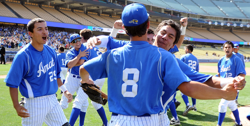 Description of . Bishop Amat pitcher Scott Hurst (8) celebrates with teammates after recording the final out and defeating Palm Desert 4-3 to win the CIF-SS Division 3 baseball championship at Dodger Stadium in Los Angeles on Friday, June 6, 2014.   (Keith Birmingham/Pasadena Star-News)