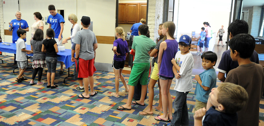 Description of . Kids line-up for ice cream during a Summer Teen Reading Club ice-cream making and tasting session at the Glendora Public Library Bidwell Forum on Wednesday, July 17, 2013 in Glendora, Calif.   (Keith Birmingham/Pasadena Star-News)