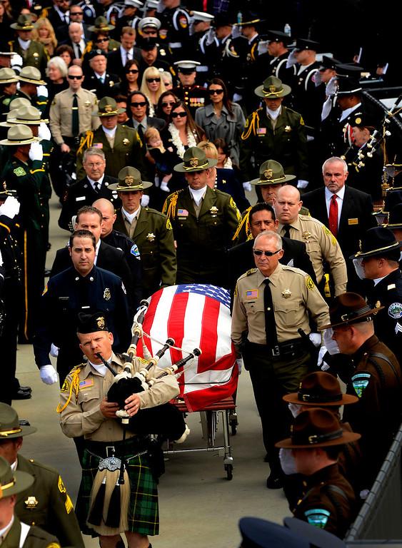 Description of . The procession for San Bernardino County Sheriff Deputy Jeremiah MacKay enters the San Manuel Amphitheater in Devore February 21, 2013.  (Photo by Gabriel Luis Acosta/The Sun)