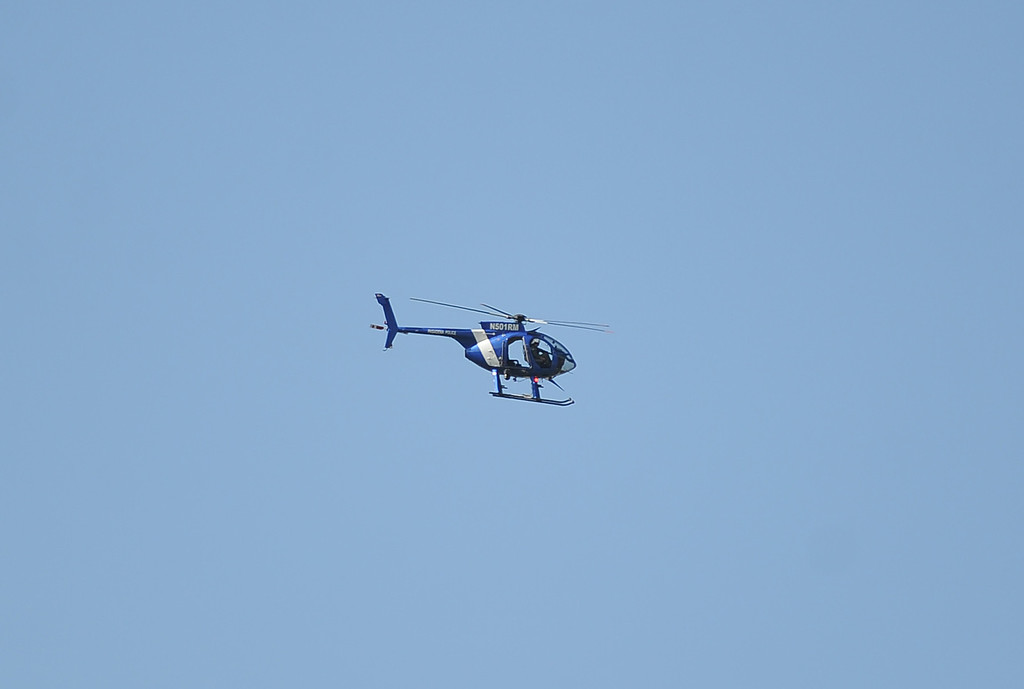Description of . A police helicopter circles the campus after a lockdown at Arcadia High School in Arcadia, Calif. on Thursday, Sept. 12, 2013.   (Photo by Keith Birmingham/Pasadena Star-News)