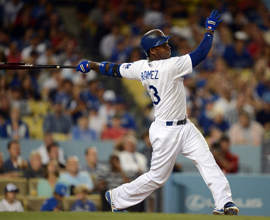 Description of . The Dodgers' Hanley Ramirez #13 slugs a 2-run homer in the 4th inning during game against the Red Sox at Dodger Stadium Friday, August 23, 2013 in Los Angeles. Dodgers won 2-0. (Hans Gutknecht/Los Angeles Daily News)