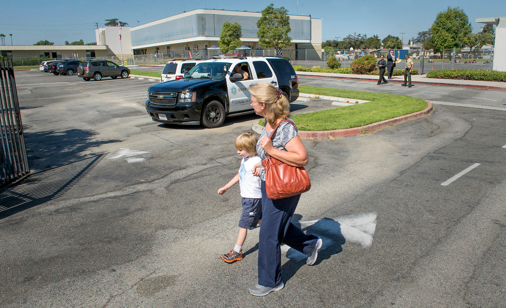 Description of . An afternoon kindergartener and parent arrives and leaves not knowing that school was canceled after a bomb threat at Longden Elementary School in Temple City, Calif. Sept. 25, 2013.  (Staff photo by Leo Jarzomb/San Gabriel Valley Tribune)