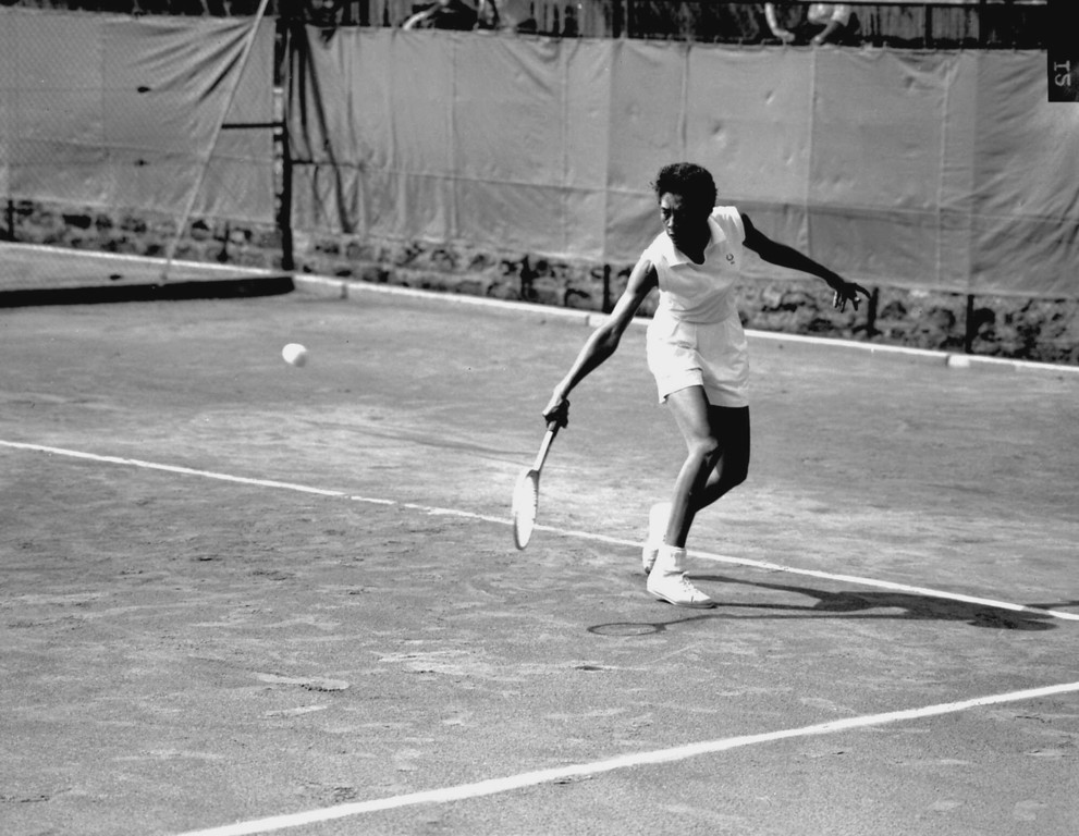 Description of . American champion Althea Gibson is shown in action at the International  Championship of Tennis at the Roland-Petit court near Paris, France, on May 18, 1956. (AP Photo)