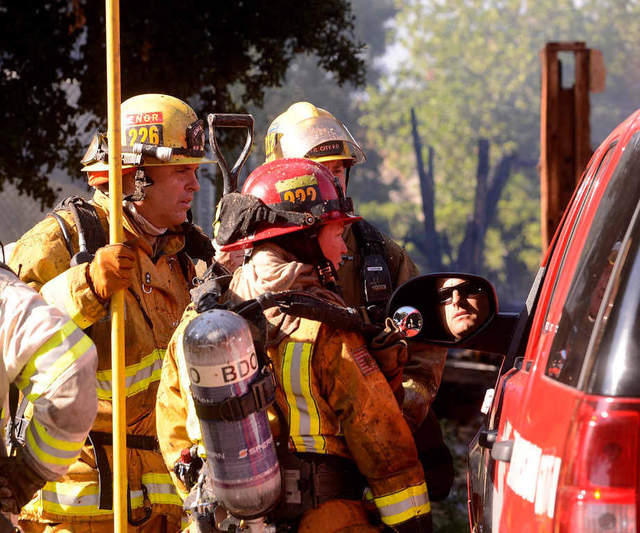 Description of . A scene of a four-alarm fire along the 700 block of Seventh Street in San Bernardino August 18, 2013. GABRIEL LUIS ACOSTA/STAFF PHOTOGRAPHER.