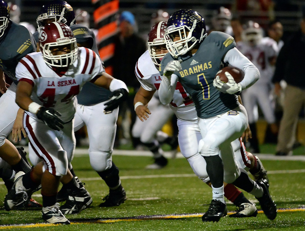 Description of . Diamond Bar's Tyler Brown (C) (1) runs for yardage against La Serna in the first half of a CIF-SS playoff football game at Diamond Bar High School in Diamond Bar, Calif., on Friday, Nov. 22, 2013.   (Keith Birmingham Pasadena Star-News)