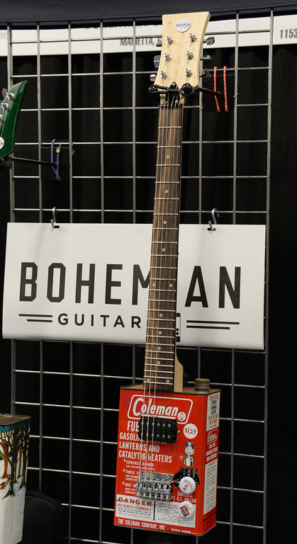 Description of . Bohemian Guitars introduces their Oil Can guitars during The NAMM (National Association of Music Merchants) Show, the world wide music trade show, at the Anaheim Convention Center in Anaheim on Friday January 24, 2014. NAMM is a music trade show drawing retailers and other industry people to Anaheim for four days of everything music. (Staff Photo by Keith Durflinger/San Gabriel Valley Tribune)