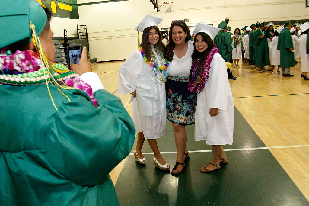 Description of . Graduates take pictures with their Instructors, during Schurr High School 2013 Commencement Exercises, at Ken Davis Field, at Schurr High School in Montebello, Thursday, June 20, 2013. (Correspondent Photo by James Carbone/SWCITY)