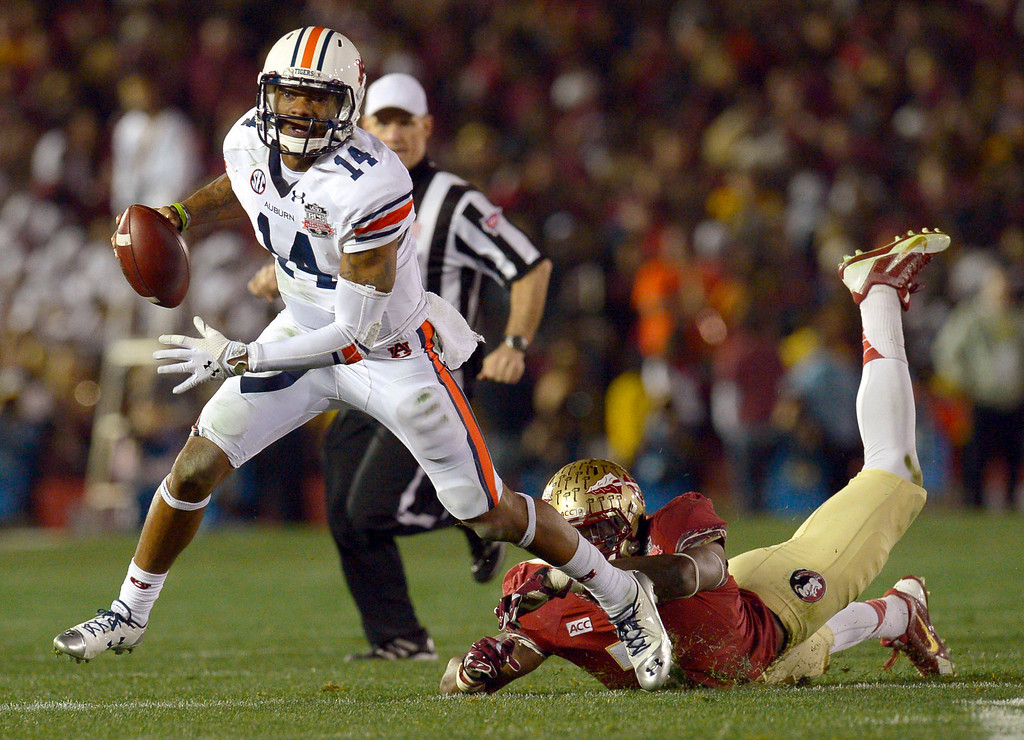 Description of . Auburn quarterback Nick Marshall carries the ball for a 11 yard gain during the first half of the 2014 Vizio BCS National Championship January 6, 2014 in Pasadena CA.(Andy Holzman/Los Angeles Daily News)