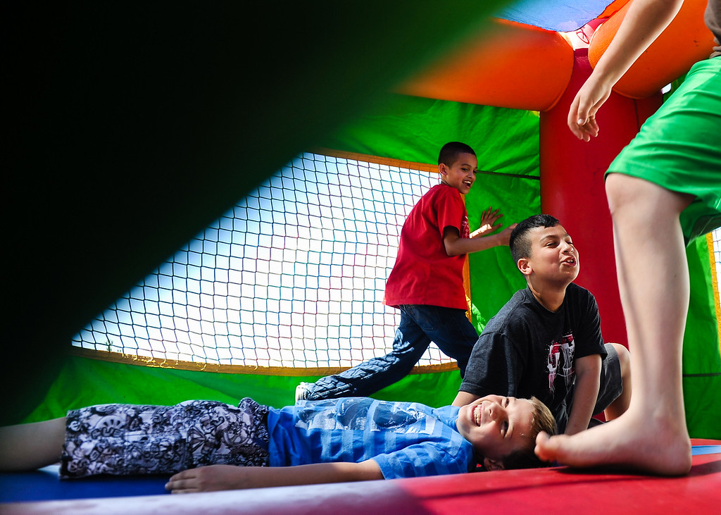 Description of . Children play in a bounce house at a community barbecue hosted by the Community Advisory Committee and Project Navigator in Hinkley, Calif. on Saturday, March 16, 2013. More than 100 residents attended the rare community gathering. (Rachel Luna / San Bernardino Sun)