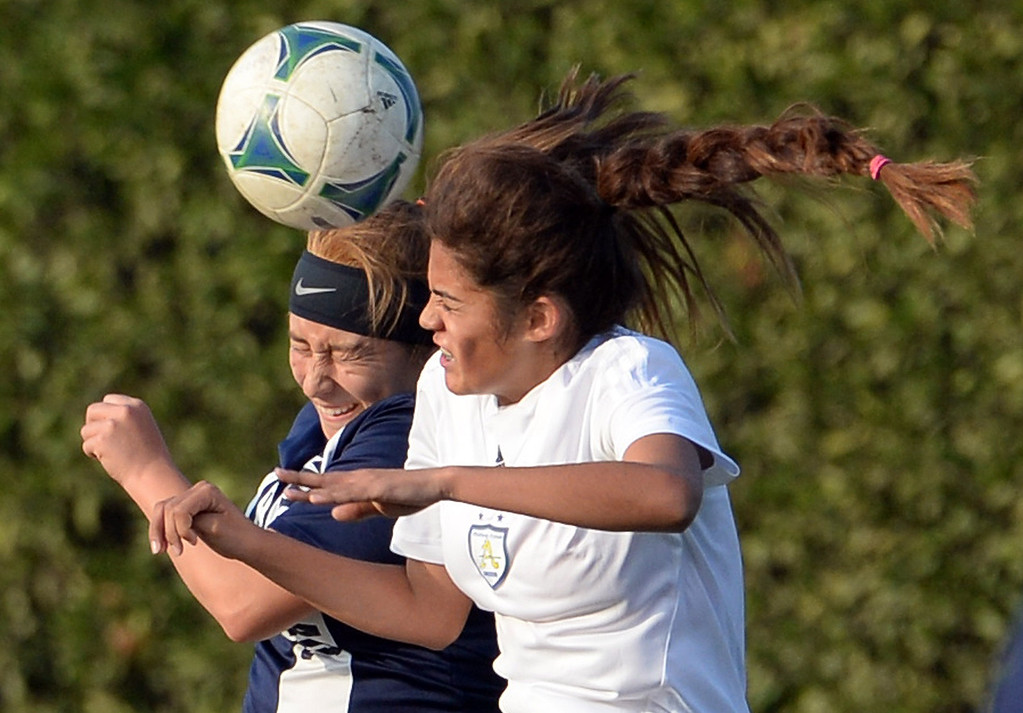 Description of . Marshall's Quetzali Del Villar, left, goes-up for the header with Bishop Amat's Brianna Yepez in the first half of a prep soccer match at Bishop Amat High School in La Puente, Calif., on Thursday, Jan. 9, 2014.Amat won 3-0. (Keith Birmingham Pasadena Star-News)