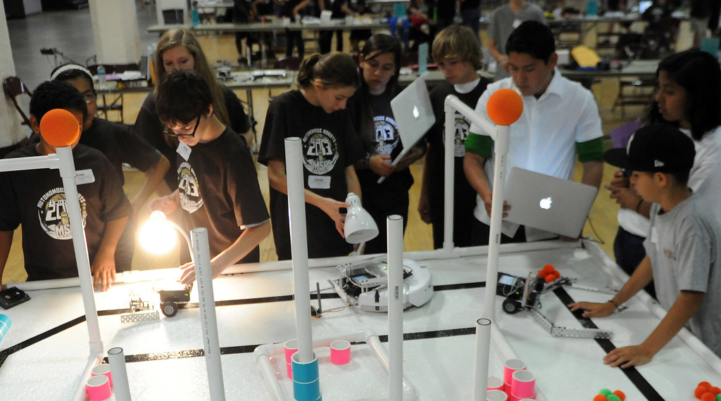 Description of . Students test their robots during the Botball Regional Tournament, part of standards-based educational robotics program. Part of a national program to encourage kids to study math, science. Kids from schools in LA County will compete to see who built best robot at the Shrine Expo Hall on Saturday, March 4, 2013 in Los Angeles.    (Keith Birmingham Pasadena Star-News)