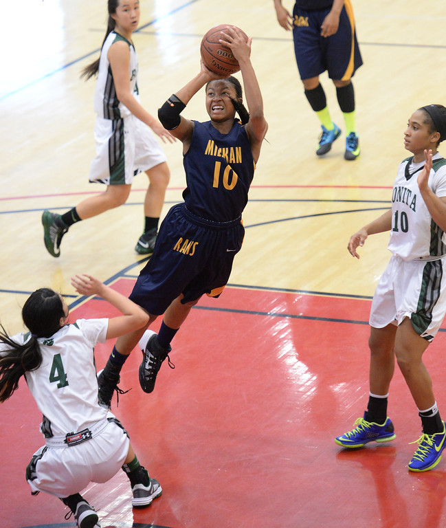 . Millikan\'s Briana Guillory drives to the basket against Bonita\'s Ariana Abo, left, and Nikki Wheatley in the CIF Southern Section Division 1-AA girls basketball final at Azusa Pacific University in Azusa, CA. on Saturday March 8, 2014. (Photo by Sean Hiller/ Daily Breeze).