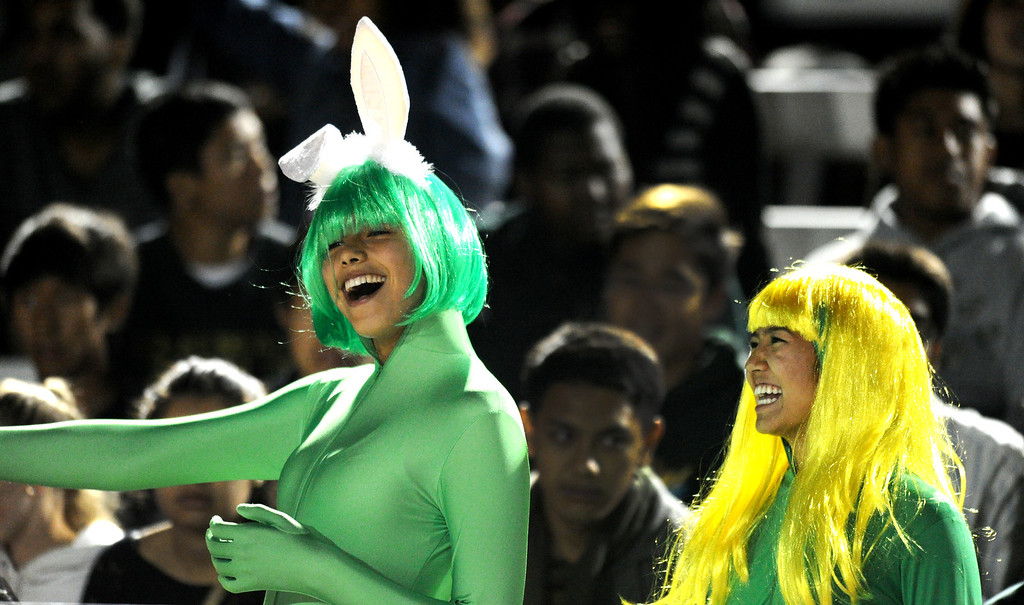 . Poly fans Zoey Jablonski, left, and Jessica Doukenick show school spirit as the Jackrabbits play Jordan in Friday night\'s Moore League football game at Veterans Stadium in Long Beach, CA. on October 11, 2013. (Photo by Sean Hiller/Press Telegram)