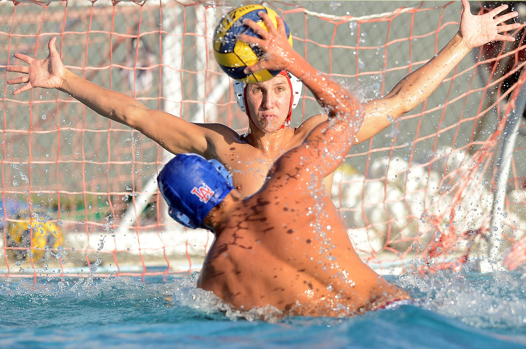 . Wilson\'s Noah Walter goes up to attempt to block a goal shoot from Los Alamitos Justin Cowan as Wilson went on to win the match 11-6 in Los Alamitos CA Tuesday September 24, 2013. (Photo by Thomas R. Cordova/ Press-Telegram)