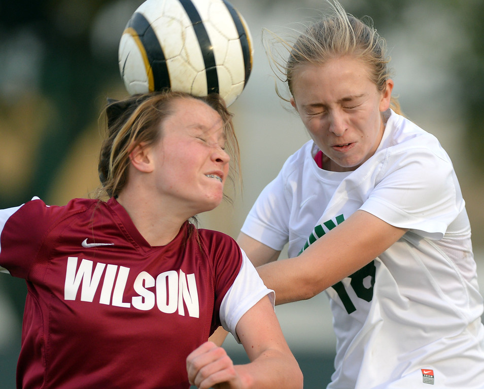 . Wilson\'s Lexy Pickup and Poly\'s Hannah Deighton converge on a header in Long Beach, CA on Tuesday, January 21, 2014. Poly defeated Wilson 1-0 in girls soccer. (Photo by Scott Varley, Daily Breeze)