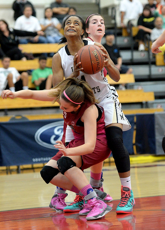 . Bishop Montgomery\'s Chelsea Lidy , top, collides with JSerra\'s Julia Ackerman in the CIF Southern Section Division 4-AA girls basketball final at Azusa Pacific University in Azusa, CA. on Saturday March 8, 2014. (Photo by Sean Hiller/ Daily Breeze).