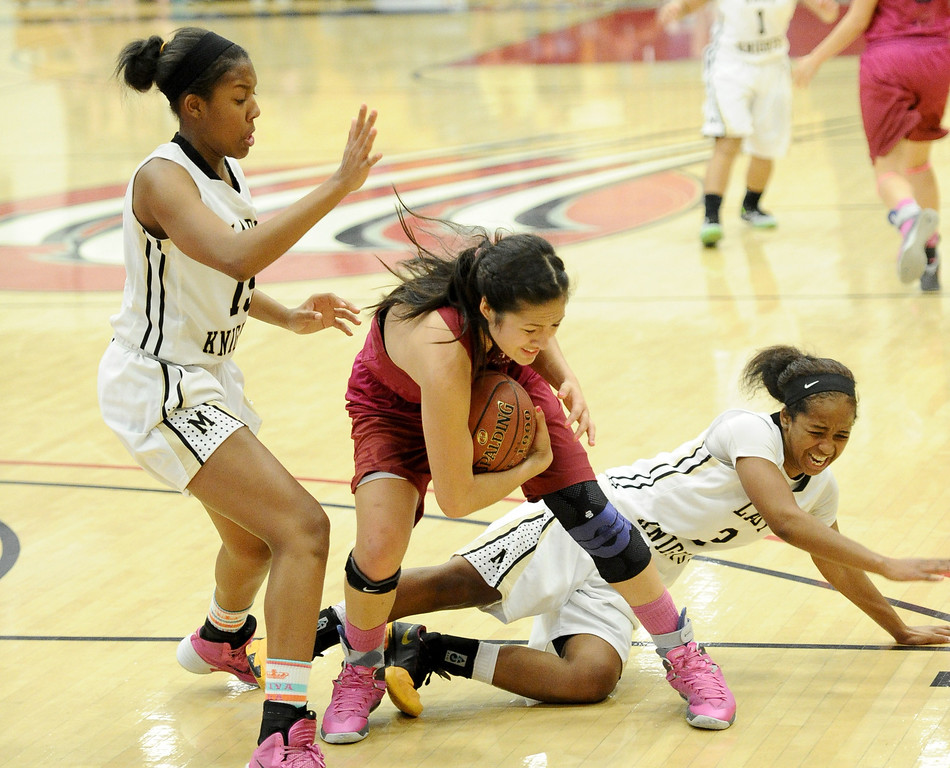 . Bishop Montgomery\'s Courtney Keaton (15), left, and Tyler Quinn (3) battle JSerra\'s Caroline Coco Miller (1) in the CIF Southern Section Division 4-AA girls basketball final at Azusa Pacific University in Azusa, CA. on Saturday March 8, 2014. (Photo by Sean Hiller/ Daily Breeze).