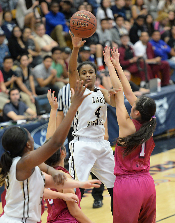 . Bishop Montgomery\'s Chelsea Lidy passes over JSerra\'s Caroline Coco Miller in the CIF Southern Section Division 4-AA girls basketball final at Azusa Pacific University in Azusa, CA. on Saturday March 8, 2014. (Photo by Sean Hiller/ Daily Breeze).