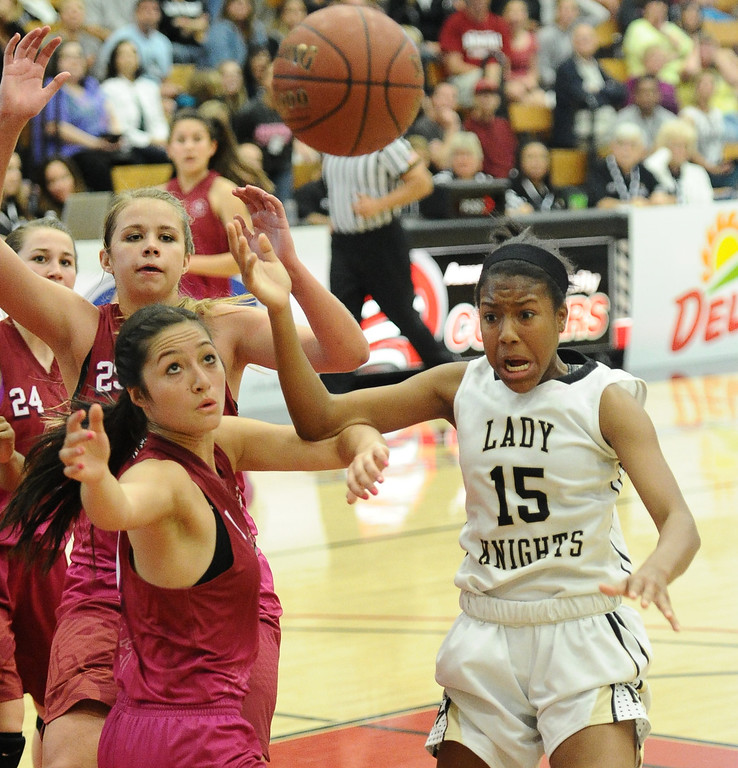 . Bishop Montgomery\'s Courtney Keaton (15) battles JSerra\'s Caroline Coco Miller (1) in the CIF Southern Section Division 4-AA girls basketball final at Azusa Pacific University in Azusa, CA. on Saturday March 8, 2014. (Photo by Sean Hiller/ Daily Breeze).
