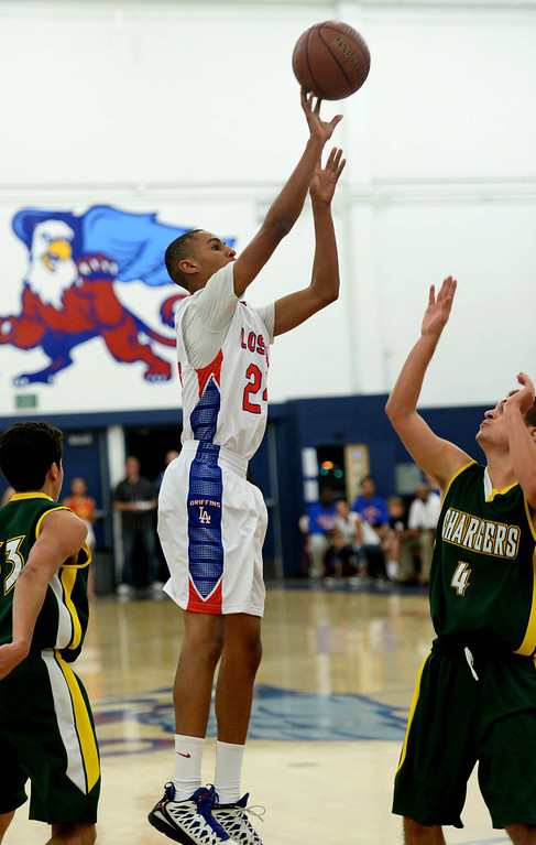 . Los Alamitos\' Eyassu Worku shoots over Edison\'s Jake Haar in the Sunset League boy\'s basketball game in Los Alamitos, CA. on Friday, January 17, 2014. (Photo by Sean Hiller/ Daily Breeze).
