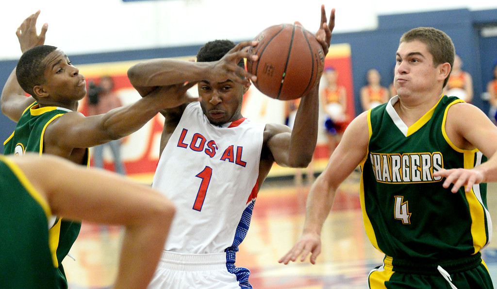 . Los Alamitos\' Khalid Washington goes to the basket against  Edison\'s Randall Walker, left, and Jake Haar in the Sunset League boy\'s basketball game in Los Alamitos, CA. on Friday, January 17, 2014. (Photo by Sean Hiller/ Daily Breeze).