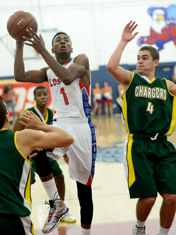 . Los Alamitos\' Khalid Washington goes to the basket against  Edison\'s Jake Haar in the Sunset League boy\'s basketball game in Los Alamitos, CA. on Friday, January 17, 2014. (Photo by Sean Hiller/ Daily Breeze).