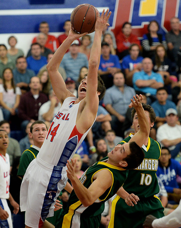 . Los Alamitos\' Chris Powelson battles Edison\'s Nick Rubio in the Sunset League boy\'s basketball game in Los Alamitos, CA. on Friday, January 17, 2014. (Photo by Sean Hiller/ Daily Breeze).