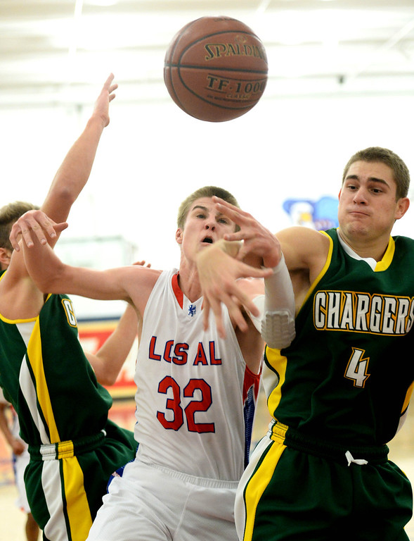 . Los Alamitos\'s Jack Kaub wrestles with Edison\'s Garrett White,left, and Jake Haar, right, in the Sunset League boy\'s basketball game in Los Alamitos, CA. on Friday, January 17, 2014. (Photo by Sean Hiller/ Daily Breeze).