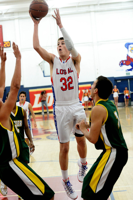 . Los Alamitos\' Jack Kaub shoots against  Edison in the Sunset League boy\'s basketball game in Los Alamitos, CA. on Friday, January 17, 2014. (Photo by Sean Hiller/ Daily Breeze).